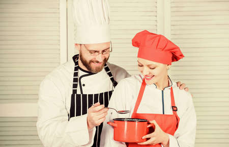 Couple having fun while whipping cream. Woman and bearded man chef cooking together. Cooking healthy meal. Delicious meal. Baking pie together. Cooking together is more fun. Let my try taste Stok Fotoğraf