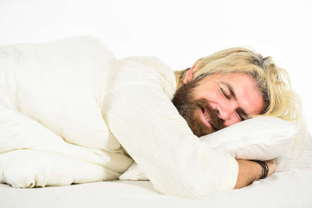 Mental health. Practice relaxing bedtime ritual. Man with sleepy face lay on pillow. Fast asleep concept. Man with beard relaxing. Having nap. Sweet dreams. Hipster with beard fall asleep. Good night Zdjęcie Seryjne