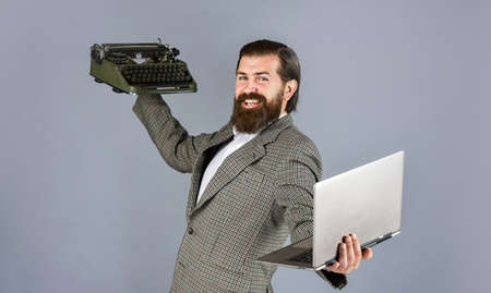 happy shop assistant. first draft. professional typist make notes typing. modern and old technology. digital business. businessman use retro typewriter and computer. mature man hold vintage device