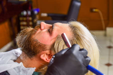 Maintaining shape. Man client. Hairdresser salon. Barbershop services. Barbershop client. Trimming beard. Perfect look. Shaving facial hair. Understand value of great haircut. Visit hairdresser