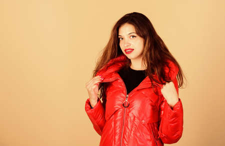 Finding right winter jacket is essential to enjoyable winter season. Snow or rain I am ready for both. Girl enjoy wearing bright jacket with hood. Warm coat. Comfortable down jacket. Red color 免版税图像 - 157891549