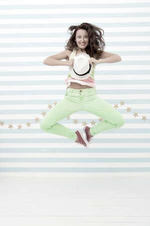 Glamour fashion model. Crazy girl in colorful sporty clothes. Happy and stylish sexy woman. Hip hop woman dancer.