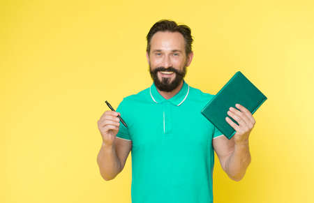 Mature hipster with beard. brutal caucasian hipster with moustache. Bearded man. Male barber care. writing new ideas. happy man with notebook and pen. Really busy. Analyzing sales pitch Reklamní fotografie