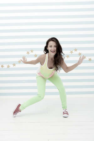 Young and free. Glamour fashion model. Hip hop woman dancer. Crazy girl in colorful sporty clothes. Happy and stylish sexy woman. Fashion and beauty. Hipster girl. Fresh funky beauty 免版税图像