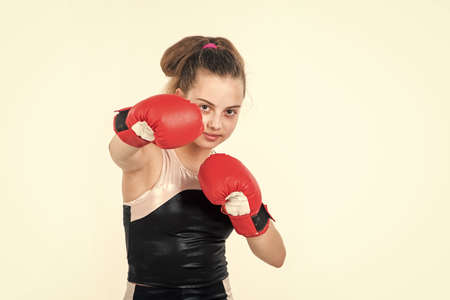 True professional. sportswear and equipment shop. healthy lifestyle. energetic kids power. child punching in gym. knockout. small girl training in boxing gloves. sport and fitness. teen girl boxer