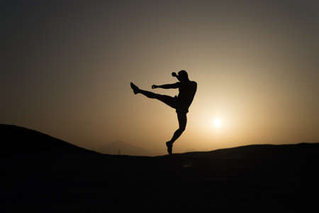 Hit your goal. Silhouette man motion jump in front of sunset sky background. Daily motivation. Healthy lifestyle personal achievements goals and success. Future success depends on your efforts now