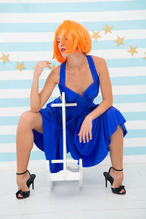 playful doll girl with crazy fashion look. Fashion girl with orange hair having fun. Crazy girl. woman in look of doll with orange hair has plaful mood. and crazy girl. happy birthday to you