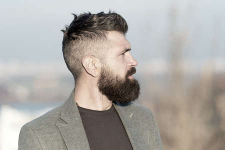 Fresh haircut. Man bearded hipster with mustache blue sky background. Beard grooming guide. Hipster serious handsome attractive guy with long beard. Barber hairdresser salon. Guy stylish long beard