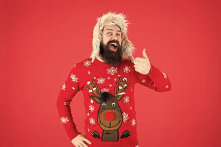 Loving cold weather. Happy new year. Join party. Winter outfit. Christmas sweater. Cheerful hipster bearded man wear christmas jumper and hat. Christmas tradition. Christmas spirit and vibe