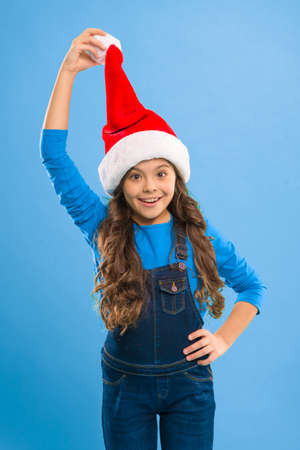 New year party. Santa claus kid. Present for Xmas. Childhood. Happy winter holidays. Small girl. Christmas shopping. Little girl child in santa hat. Christmas is coming. Beat the Christmas rush
