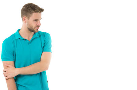 Athlete injured elbow joint. Man suffers old trauma chronic pain elbow white background. Sportsman risks taker exercising physical trauma. Guy painful face touches injured elbow. Feeling pain again