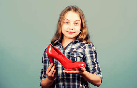 Glamour high heels. Female attribute. Shoes shop. Child play with moms shoes. Awesome red stiletto shoes. Little fashionista kid with high heels. Every girl dreaming about fashionable high heels