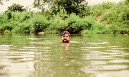 Swimming skills. Refreshing feeling. Man enjoy swimming in river or lake. Submerge into water. Freshness of wild nature. Summer vacation. Deep dangerous water. Relaxation and rest. Swimming sport