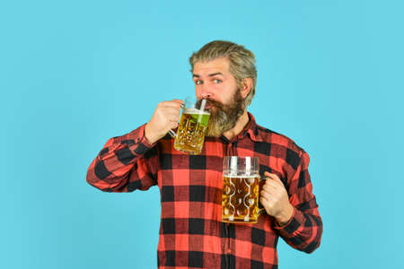 i like the taste. Man hold glass of beer. hipster at bar counter. having fun watching football. Brutal bearded male drinks beer from glass. Beer pub. Stylish bartender or barman in bar. recreation Stock fotó