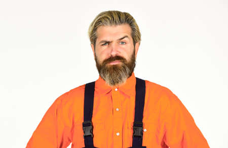 Mechanic perform technical work. Bearded mature man in uniform. Reputation of excellent worker. Skillful worker. Electrician plumber handyman. Repairman. Construction worker. Renovation concept Stock fotó