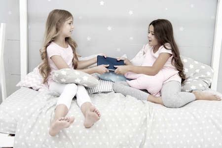 Sisters rivalry concept. Sisters relations issues. Share book with friend. Children in bedroom want read evening fairy tale. This is my book. Girlish rivalry. She dont want to share her book