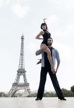 dance couple in front of Eiffel tower in paris, France. beautiful ballroom dance couple in dance pose near Eiffel tower. romantic travel concept