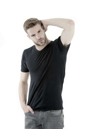 perfection. male fashion. man isolated on white background. unshaven muscular man. handsome macho. male fashion and beauty. barbershop. guy in black shirt. casual style. Black fashion trend