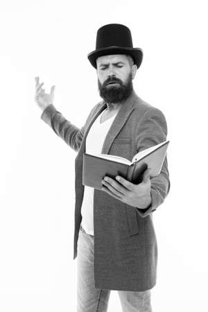 Literary criticism. Faced with senseless drama. Eloquence and diction. Bearded man read book. Poetry reading. Book presentation. Literature teacher. Books shop. Guy classic outfit read book