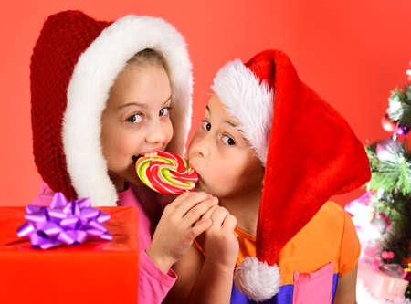 Girls celebrate winter holidays together. Children with glad faces Stock Photo