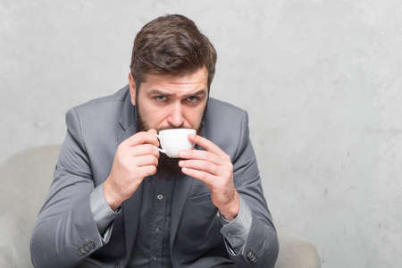 Coffee can do it best. Businessman drinking coffee before work. Bearded man enjoying coffee break at office. My perfect morning is spent drinking coffee