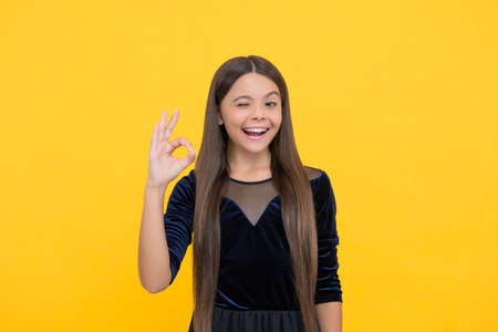 Everything is cool. Happy child show OK yellow background. Cool look of little girl. Hair salon. Fashion style. Trendy clothes for kids. Childrens day
