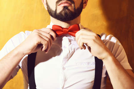 bearded man with serious face on studio wall background