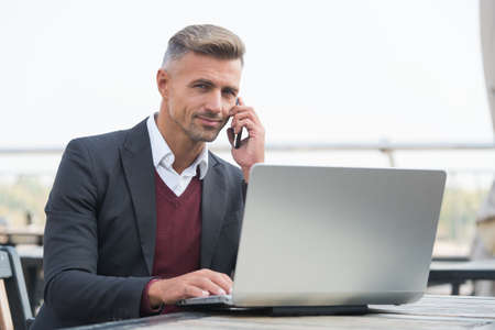 Sales manager talk to client on mobile phone using computer technology for selling and buying online, e-shop