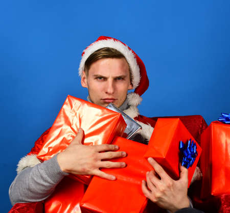 Christmas and New Year concept. Man holds xmas presents