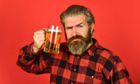 hipster dude with mustache. mug of alcohol beverage. confident bartender. barman in bar. rest at pub. Cheers. sport bar. trying a new beer. brutal hipster drink beer. mature bearded man beer glass Stockfoto