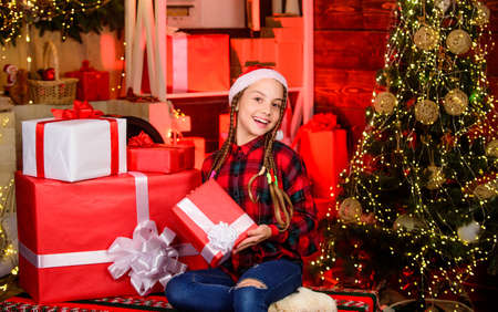 All I want for Christmas. morning before Xmas. family holiday time. new year is coming. Kid enjoy the holiday. child girl with xmas present. hello from santa claus. small happy girl at christmas tree Stok Fotoğraf