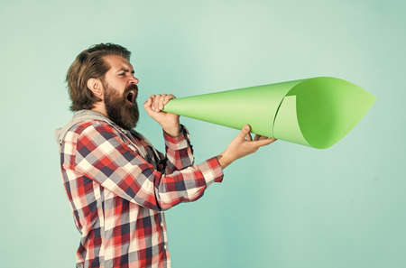Civil rights. mass media concept. make voice louder. bearded man shout in megaphone. man with paper loudspeaker. freedom of speech. ads for everyone. Promotion and information expansion to masses Banco de Imagens