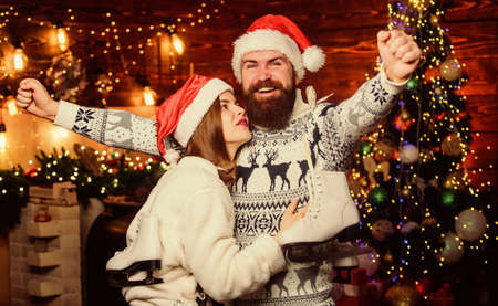 Wishing a happy New Year. winter holidays. Sport and hobby. happy new year. Winter activity outdoor. merry christmas. Loving couple. family love figure skating. couple in love. Man and girl santa hat