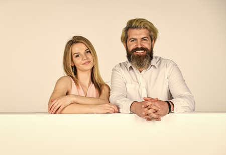 happy couple in studio. young family portrait. bearded man and woman. smiling girl has blonde hair. brutal mature hipster in shirt. corporate couple with copy space. friendship or love