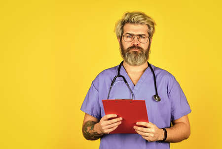 Hospital treatment. Seek urgent medical attention. Evidence based medicine. Treatment protocols. Treatment relieve symptoms body fights infection. Coronavirus concept. Man bearded doctor with folder