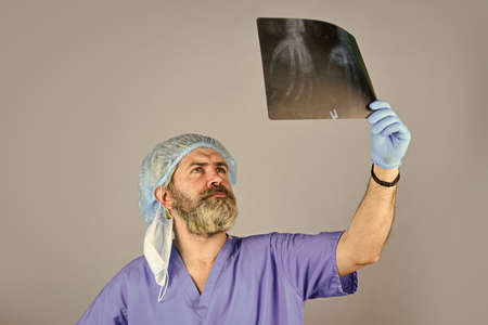 doctor examines radiographical snapshot. x-raying of hands. nurse checking x-ray film at hospital. health problems. Surgery operation and medical concept. man look at roentgen. Radiologist hold xray Stok Fotoğraf