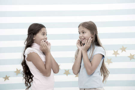 Amazing surprising news. Girls excited expression. Girls kids just heard amazing news. Surprised children excited about rumors. Secret little lies or gossips. Girlish gossip. Exciting rumor or news