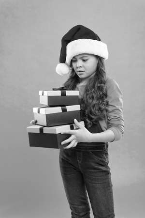 Christmas celebrated throughout globe. Small girl hold pile gift boxes. Generous gift concept. Shopping online. Winter sale. Child got surprise gift. Happy new year. Packaging for gifts. Lot presents