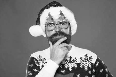 Santa needs good beard. Hipster touch beard hair in festive style. Bearded man with long mustache and beard. Beard styled for santa claus look. Mens grooming salon. Barbershop Stock Photo