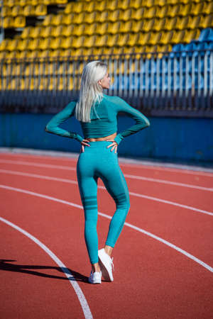Having a little break. lady in fitness sportswear. beautiful pumped body. training and workout. athletic female coach. woman sport trainer. healthy sporty lifestyle. health and energy. diet