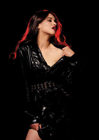 Desire concept. Passionate attractive woman makeup face. Red lips smoky eyes. Passionate lady. Impeccable appearance. Mysterious passionate fashion model in leather cloak. Feminine and glamorous