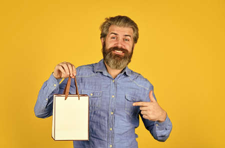Shopaholic. mature hipster carry shopping bag. cyber monday or black friday. Thanks for your purchase. happy man with beard after shopping. best sale and discount here. gifts for holiday
