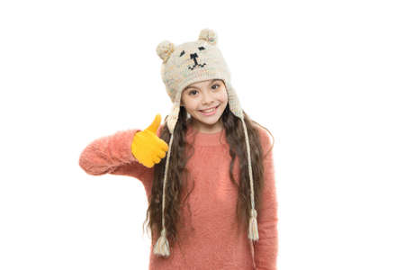 best choice. ski resort. get ready for winter holiday. homemade knit. little playful girl in winter look smiling. Fashion concept. cute beauty isolated on white. warm in any weather. let it snow