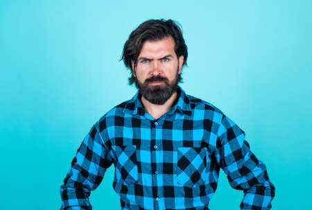 serious caucasian guy with brunette hair having perfect beard and moustache, hairdresser