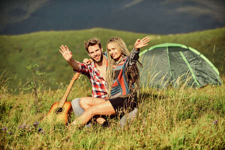 Love in look. couple in love spend free time together. western camping. hiking. friendship. campfire songs. men play guitar for girl. happy friends with guitar. country music. romantic date