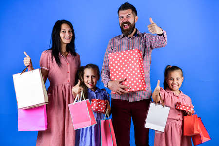 mother father and children go shopping, family Stock Photo