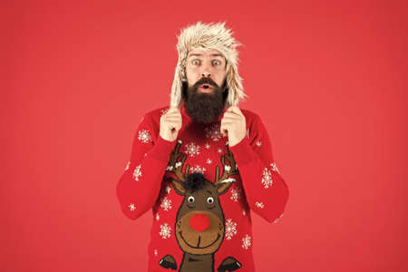 male winter fashion. surprised about cold weather. wear warm clothes in cold season. hipster with beard in favorite sweater. knitwear and fur accessory. completely happy in new year. merry christmas