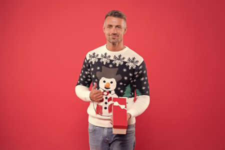 happy new 2020 year. smiling macho man after shopping. sexy man winter sweater. winter holidays. his favorite sweater. christmas time. open xmas gift. enjoy xmas party. present from santa. I wish