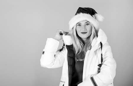 Jacket has extra insulation and slightly longer fit to protect your body from sharp winter weather. Santa girl. White jacket. Waiting frosty christmas days. Girl wear white jacket and santa hat
