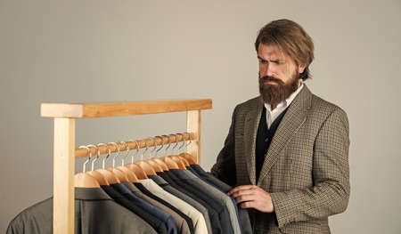 In search of inspiration. bearded man tailoring clothes. formal and office wardrobe. businessman. confident tailor designing male jacket. handsome sartor with tape measure. male beauty and fashion